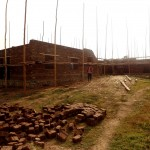 raising the walls with the bricks made by the inhabitants